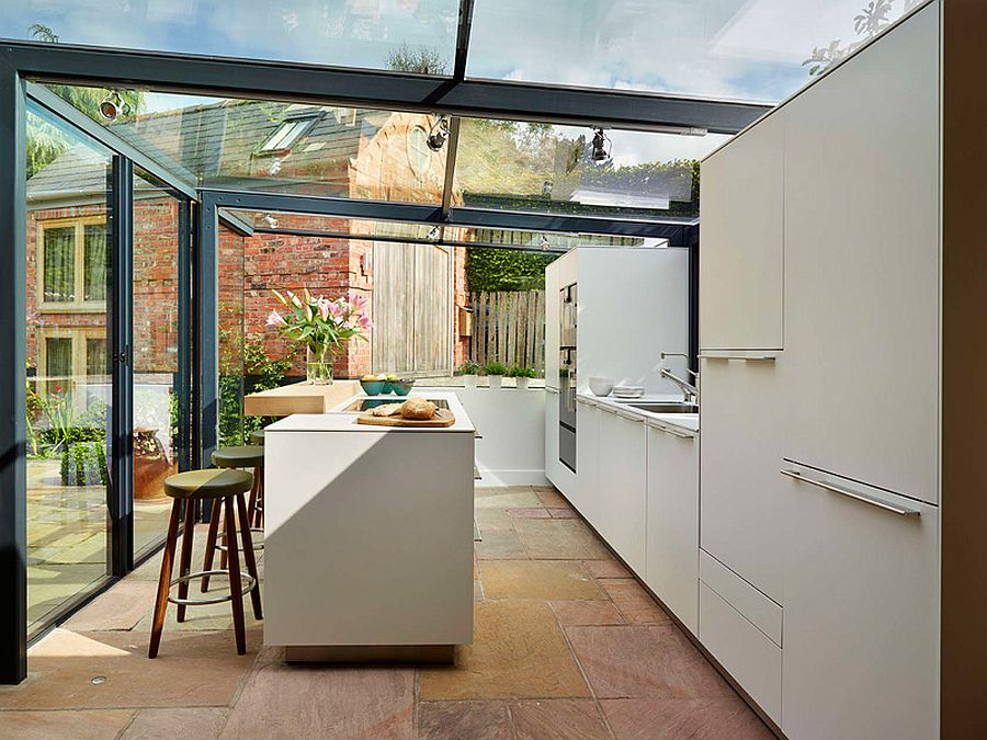 Cool-Bulthaup-kitchen-encased-in-a-glass-box-with-steel-frame-and-a-stylish-island